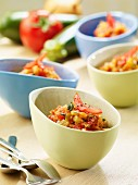 Courgette and tomato relish in several small bowls