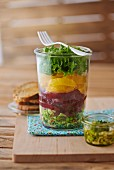 Layered salad with beetroot and oranges