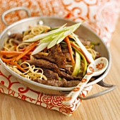 Pasta with strips of beef and vegetables
