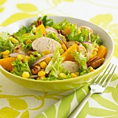 Lollo biondo lettuce with chicken oranges, sweetcorn and pecan nuts