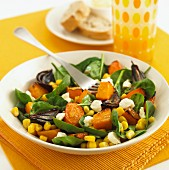 Salad with roasted diced squash, lamb's lettuce, sweetcorn and feta