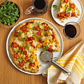 Vegetable pizza with peppers, sweetcorn and tomatoes (view from above)