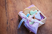 Heart-shaped biscuits in a wooden box with a ribbon