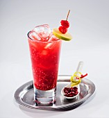 Fruit cocktail with cranberries on a silver tray