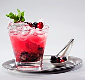 Fruit cocktail with wild berries on a silver tray