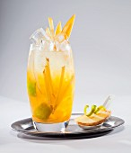 Fruit cocktail with ginger juice on a silver tray