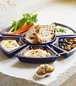 Houmous with vegetable batons, olives and bread