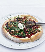 Pizza with beetroot, walnuts and parsley