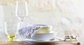 A place setting with two glasses and silver cutlery