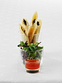 Filo pastry 'cigars' with a red dip