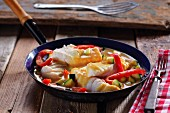 Pan-cooked fish with peppers and courgette