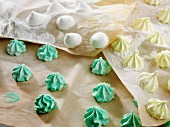 Assorted meringue bites on grease-proof paper