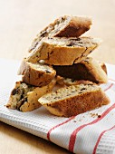 Stacked biscotti on a tea towel