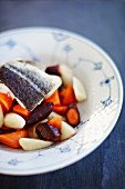 Cod fillet with root vegetables and carrots