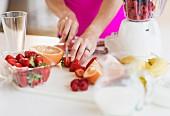 A woman slicing fruit