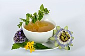 Herbal tea and ingredients (lemon balm, passion flower, St. John's wort, hops, lavender and orange flowers)