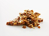 Nut brittle against a white background