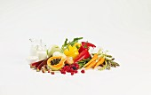A still life featuring fruit, vegetables and dairy products