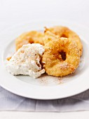 Apple fritters with whipped cream