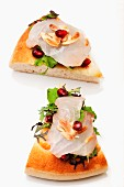 Pizza with fish carpaccio, rocket, almonds and pomegranate seeds