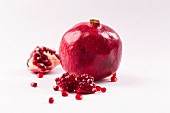 Whole pomegranate and pieces of pomegranate
