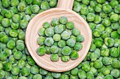 Peas in a wooden spoon
