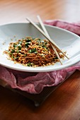 Chilled Sesame Noodles with crumbled roasted peanuts and a mix of basil, cilantro, and parsley