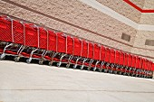 Supermarket trolleys in a long stack