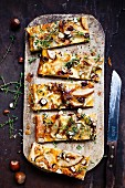 Pear and cheese tart with hazelnuts