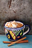Mexican hot chocolate with cinnamon sticks