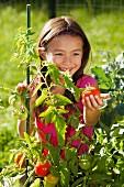 Mixed race girl gardening