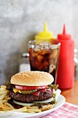Hamburger and french fries in diner