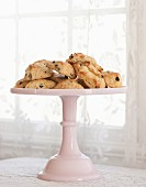 Scones with raisins on a cake stand