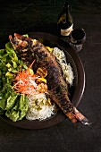 Barbecued sea bass with noodles, vegetables and mixed lettuce