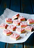 Coconut ice squares with grated coconut