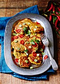 Sweetcorn fritters with chilli rings, spring onions and coriander
