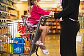 A mother and daughter with a shopping trolley in the supermarket