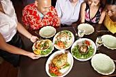 Friends eating in a Thai restaurant