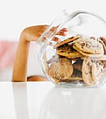 Close up of mixed race girl taking cookie from jar
