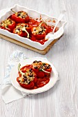 Stuffed peppers with barley and kidney beans in tomato sauce
