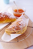 Apple turnovers with icing sugar and jam