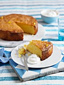 Citrus fruit and polenta cake, one slice cut