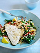 Quinoa with vegetables and grilled fish