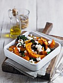 Baked squash with feta, broccoli and pumpkin seeds