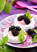 Meringue nests with blackberries