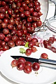 Red gooseberries on a garden table