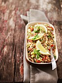 Bulgur salad with cucumber, onions, tomatoes, parsley and lemon wedges