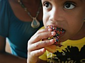 Child Eating Doughnut with Sprinkles
