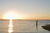 Man Fly Fishing at Sunrise, Florida Keys, USA