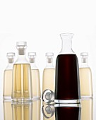 Bottled Light and Dark Vinegar on White Background